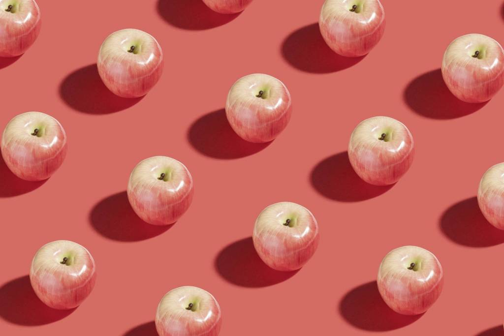 Apples Sitting on a Plain Background