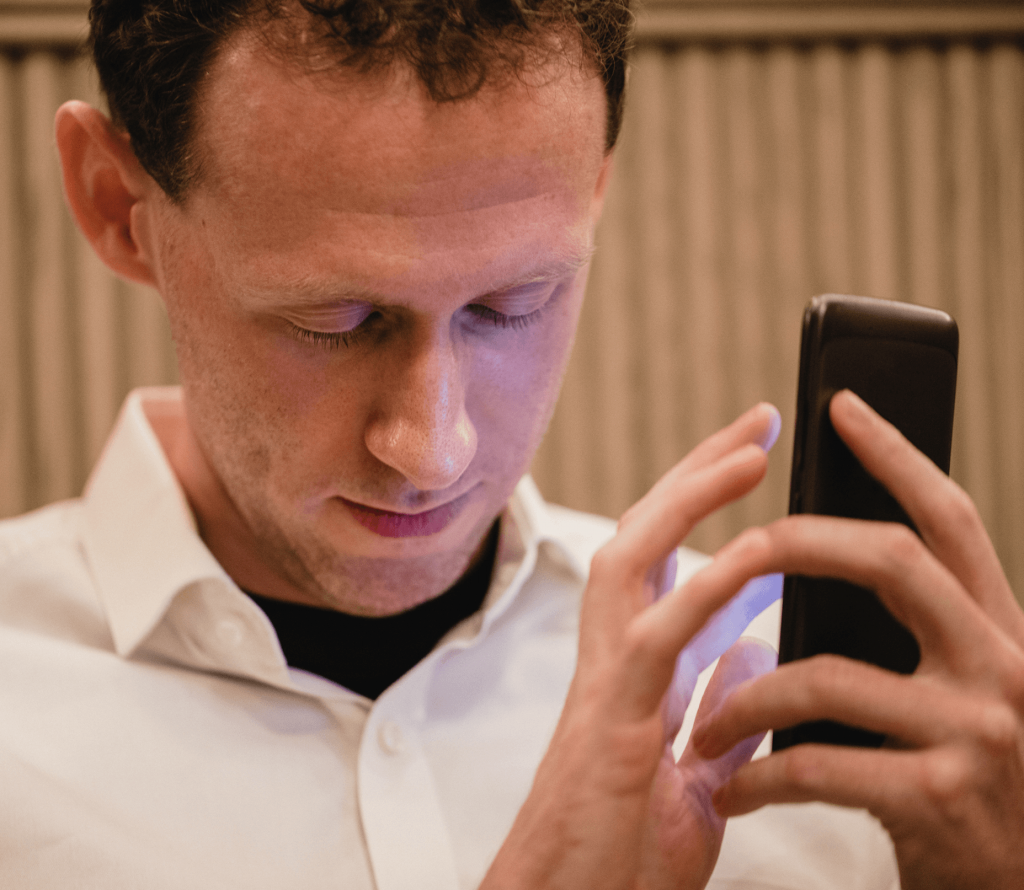 photo of a visually impaired man using an accessible mobile app