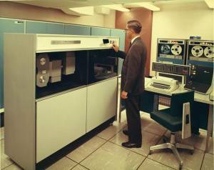 Photo of computer technician at work with an old mainframe computer
