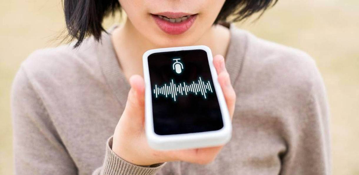 person speaking voice search to mobile smartphone assistant